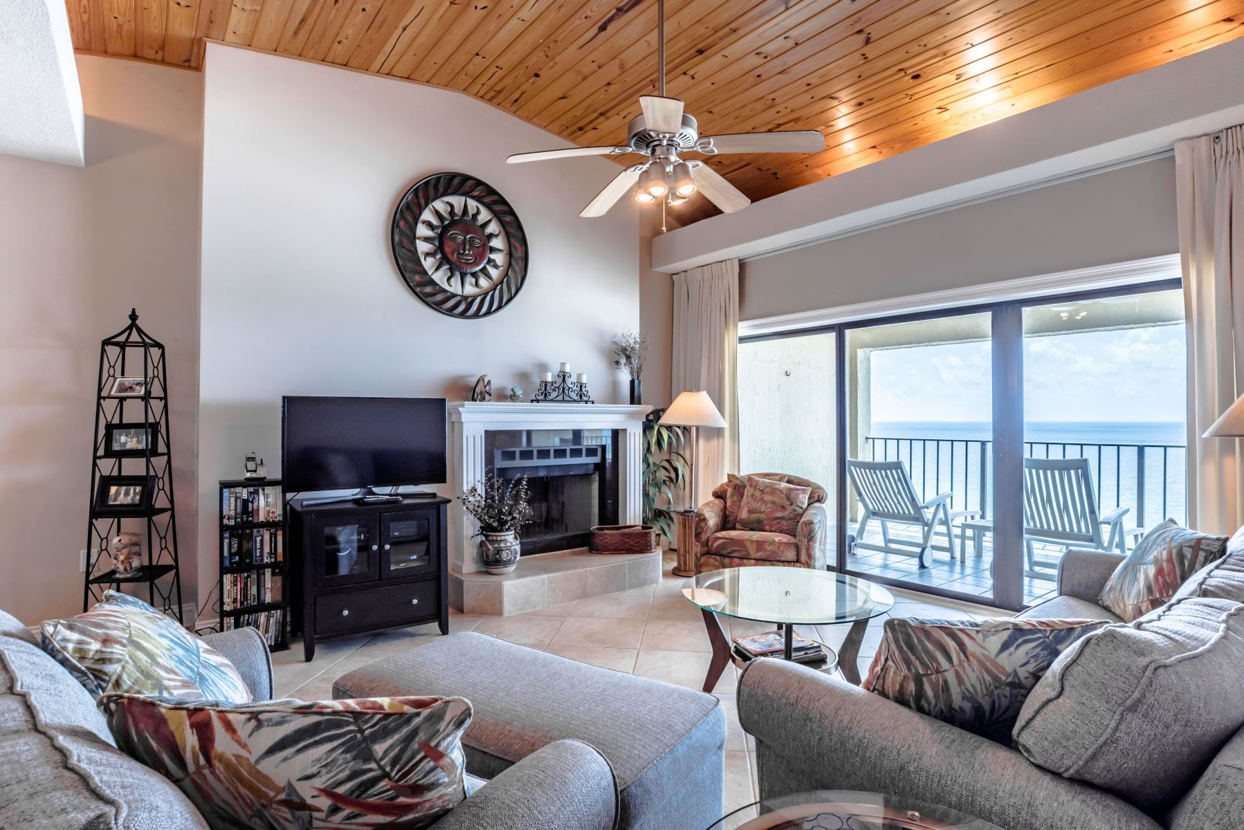 Livingroom view of a Shipwatch Perdido Key vacation rental beachfront with fireplace