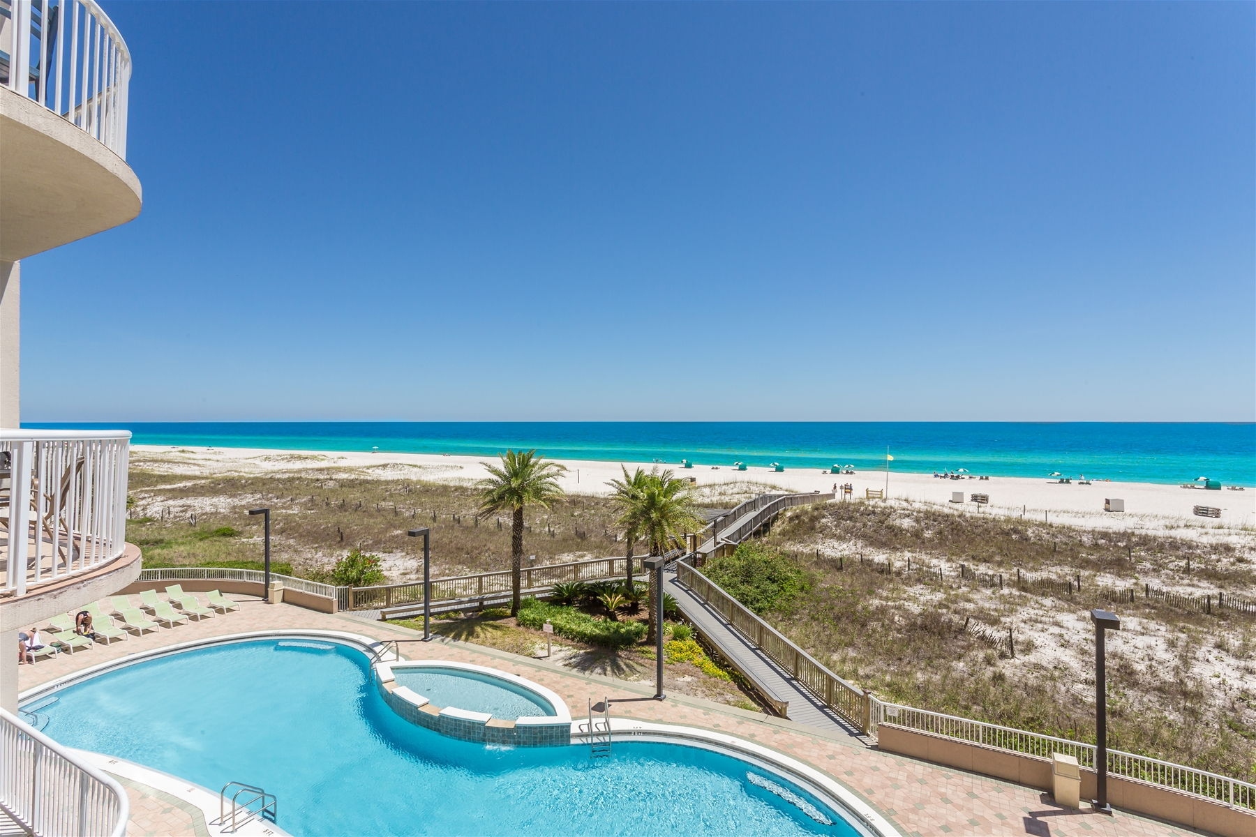 elevated condo view of the beachfront pool and beach access at Spanish Key, Perdido Key